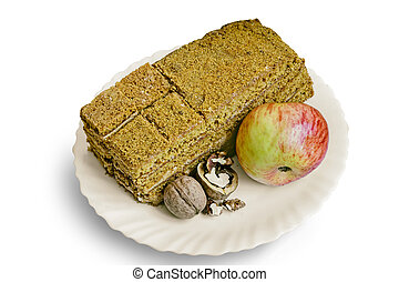 Cake , Apple and walnuts on the plate.
