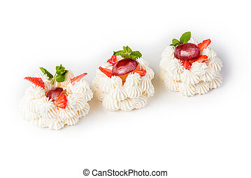 cake bee Meringue cake with strawberries and grapes on a white background