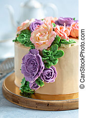 Cake decorated with buttercream flowers.