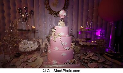 Cake for a child with a bear, a large pink cake, a birthday cake for a child