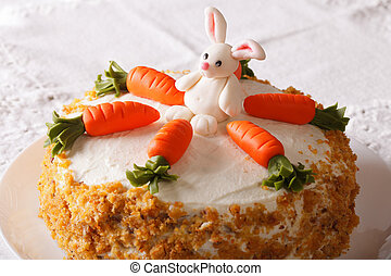 Cake for children, decorated with carrot and bunny close-up