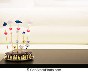 Cake for you - cake with brown cream on the top with topper