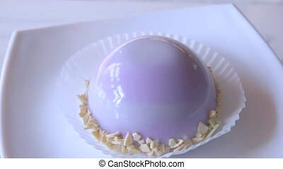 Cake in a shape of dome with purple glaze. Yummy...