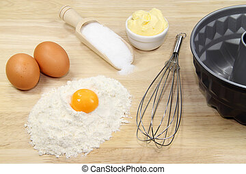 Cake mixture - Baking ingredients with eggbeater and cake...