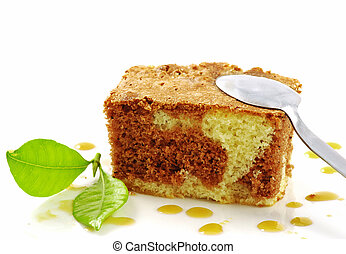 Cake - Nice marble cake with a spoon and a fresh green leaf