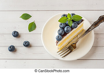Cake of a souffle with glaze and fresh blueberries. - Cake...