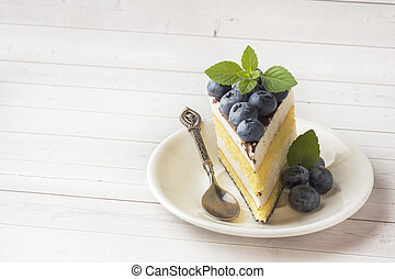 Cake of a souffle with glaze and fresh blueberries. copy...