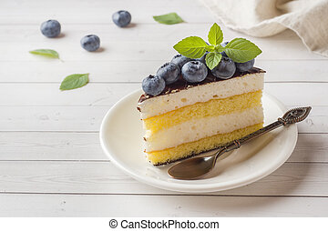 Cake of a souffle with glaze and fresh blueberries.