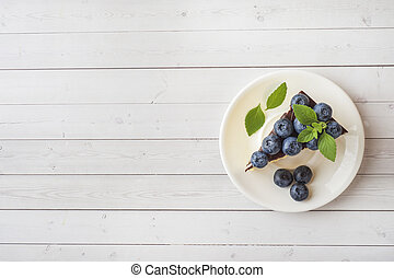 Cake of a souffle with glaze and fresh blueberries. Top view...