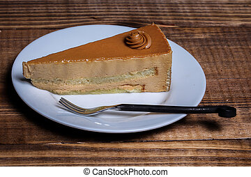 Cake on plate with wooden background