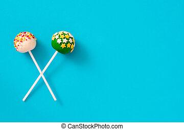 Cake pops on blue background