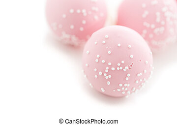 Cake pops - Pink cake pops on a white background.