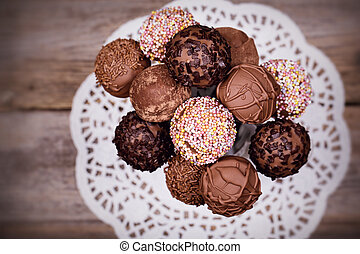 Cake pops - Chocolate cake pops in a white jug. Overhead...
