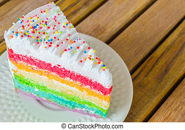 Cake - Rainbow cake in white dish on the wood table