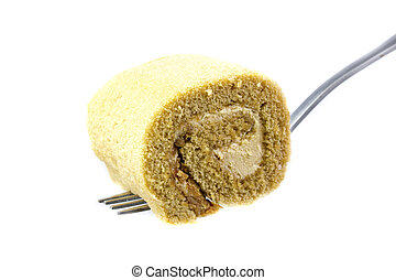 Cake roll on white background with a spoon