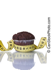 Cake temptation - a measure tape and a cake, bad food...