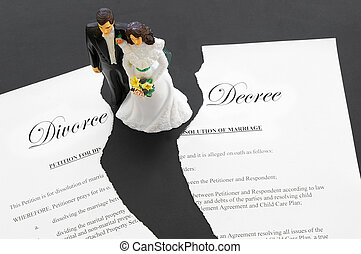 cake-topper wedding couple on a torn divorce document