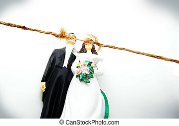 cake topper wedding couple with frayed string representing stress