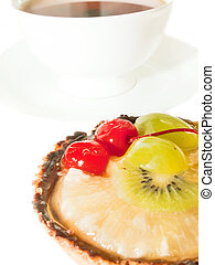 Cake with Berries and fruits over white. cup of tee on background