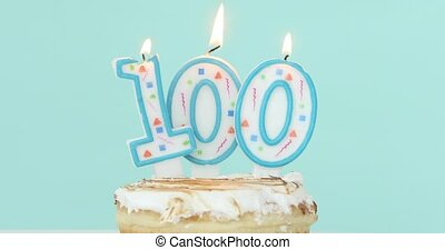 Cake with burning candles as number one hundred