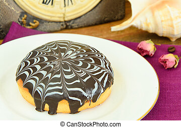 Cake with chocolate on a plate.