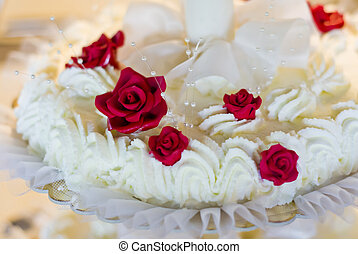 cake with cream and scarlet roses