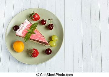 Cake with fresh fruits, copy space and selective focus