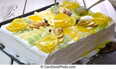 Cake with fruits and jelly. Preparation of delicious dessert...