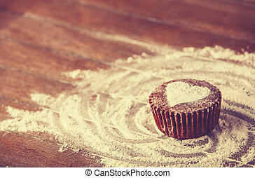 Cake with heart. Photo in old color image style.