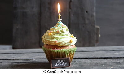 cake with one candle, birthday candle that have just been blown out with smoke