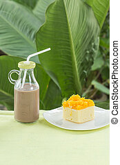 cake with Slice Gold york egg and chocolate milk