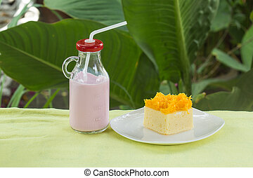 cake with Slice Gold york egg and strawberry milk