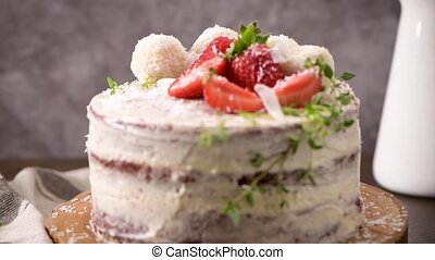 cake with strawberries on kitchen counter top.