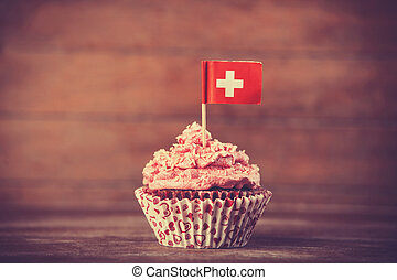 Cake with Suisse flag. Photo in vintage color style