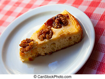 Cake with walnuts on white plate