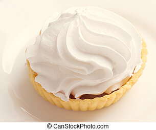 Cake with whipped cream on a plate