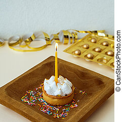 Cake with white cream and a candle