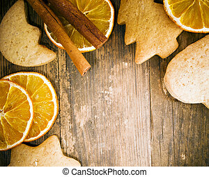 Cakes and orange tastefully arranged on wooden table.