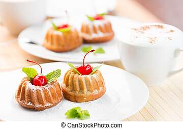 Cakes dessert with cappuccino coffee cup