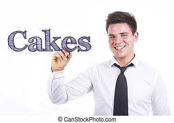 Cakes - Young smiling businessman writing on transparent surface