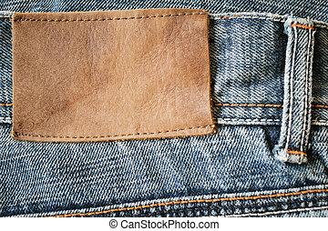 calças brim, etiqueta