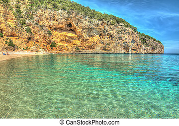 Cala Biriola on a clear day in hdr
