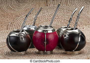Calabash Mate Cups - Group of calabash mate cups with straws...