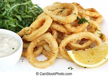 Fried calamari, with arugula salad, tartare sauce, and lemon.