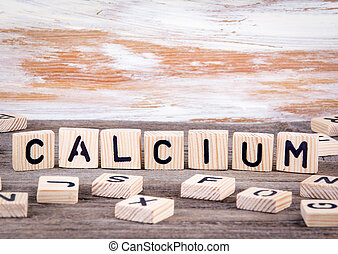 Calcium from wooden letters on wooden background