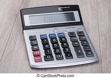 calculadora, en, tabla de madera