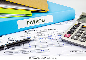 Calculate payroll for employee - PAYROLL word on blue binder...