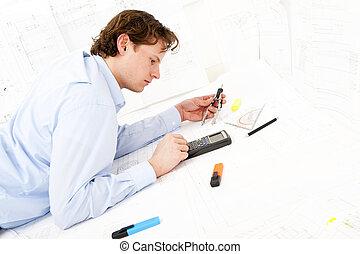 Calculating - Industrial design engineer calculating...