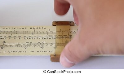 Calculations on a slide rule.