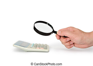 Calculator and a hand with a magnifying glass.